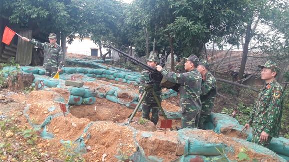 Ban CHQS huyện Huấn luyện khẩu đội phòng không 12,7mm.jpg
